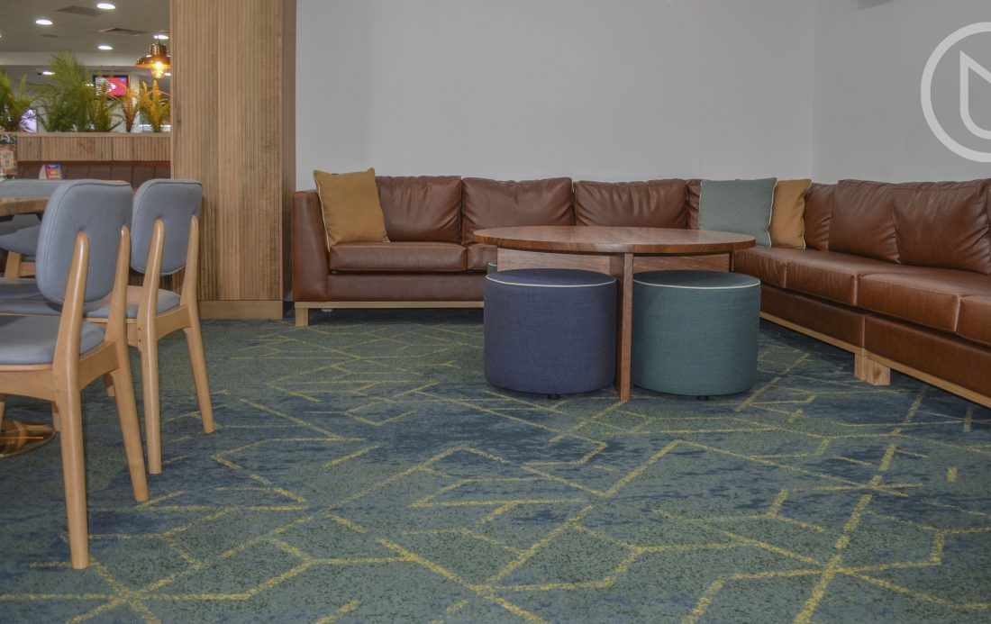 Axminster woven cut pile carpet of 80% wool 20% nylon.