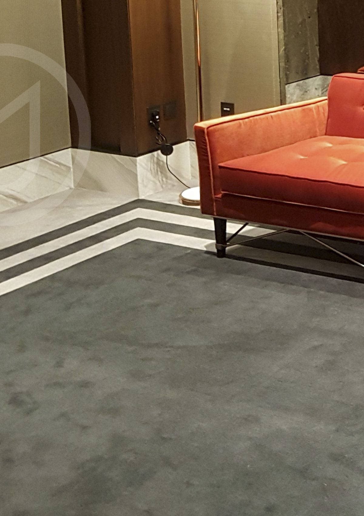 A combination of Axminster and hand tufted carpet