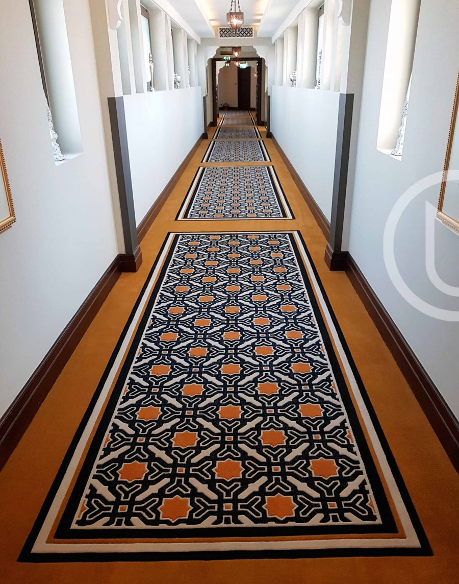 Carved Axminster woven cut pile carpet of 80% wool 20% nylon.